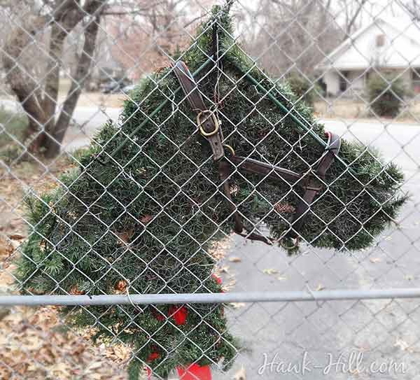 back view of a homemade horse wreath