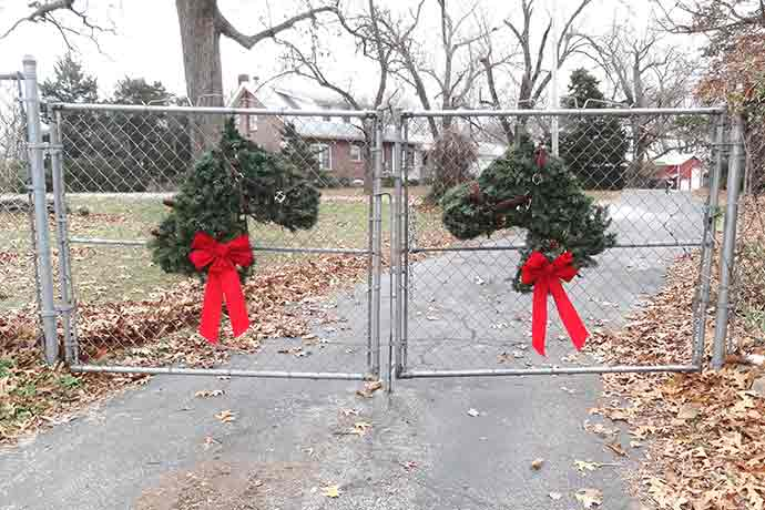 horse wreaths on hawk hill's front gates