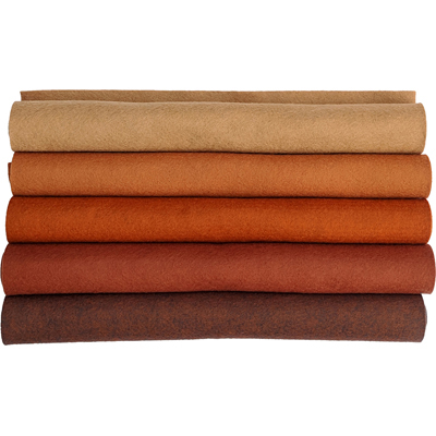 a stack of brown felt in different shades