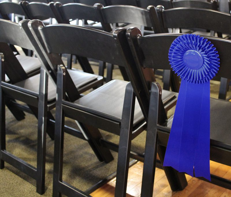award ribbon on the back of an event chair
