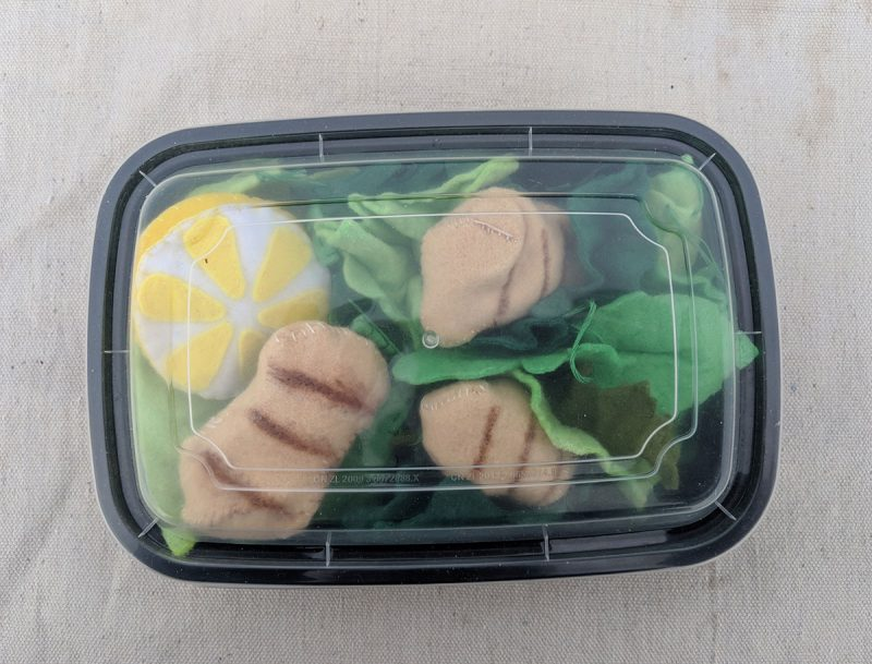 packaging felt food in meal prep containers is an easy way to package your food and helps keep play kitchens tidy.