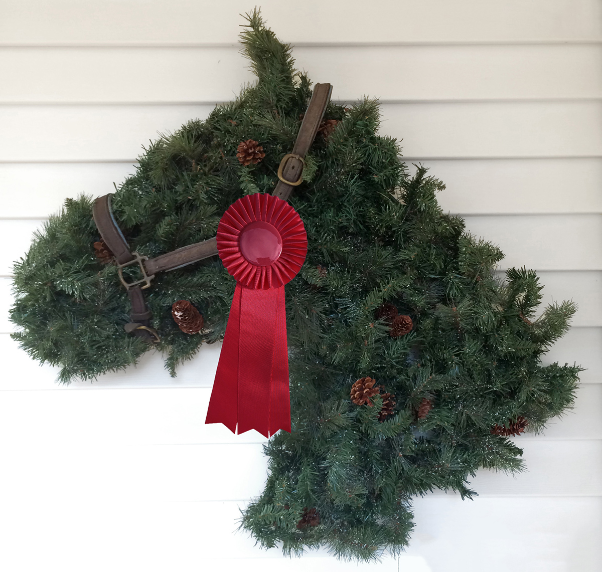 Red horse show ribbons on a horse wreath are fun and festive
